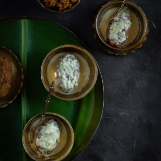 Chirer DoodhPuli (Flattened Rice Dumplings with Coconut Jaggery Stuffing, in Milk)