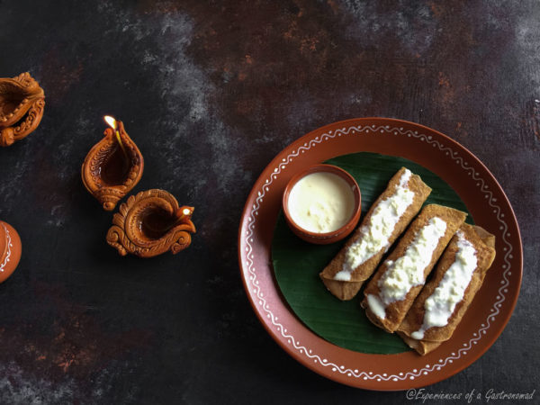 Mugshapta | Moongshapta (Yellow Moong Dal Crepes with a Coconut Jaggery Filling)