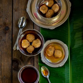 Roshbora (Urad Dal Fritters in Jaggery Syrup)