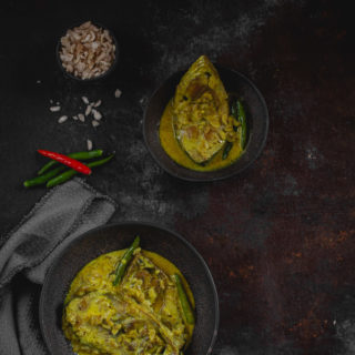 Ilish Chirer Jhol (Hilsa Curry with Fried Flattened Rice)